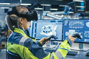 Employee using VR to learn work processes.